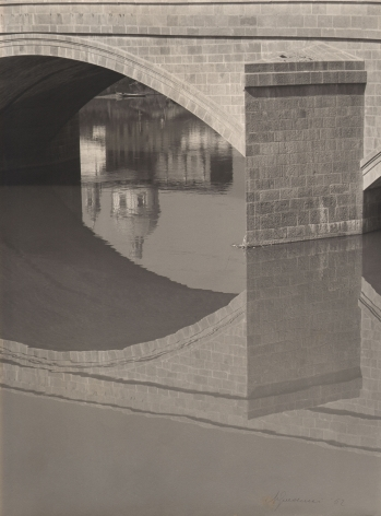 Alberto Galducci, Untitled, ​1952. Detail of an arched bridge and its reflection on a still body of water.