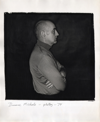 Anthony Barboza, Duane Michals - Photographer, ​1979. Subject stands in profile facing right in the center of the square frame with arms crossed.