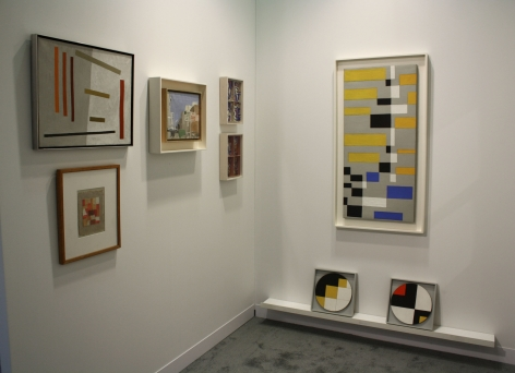 "(from left) Alice Trumbull Mason, ""Remembrance,"" 1962, oil on canvas, 16 x 20 in., Anne Ryan, Untitled, 1948-54, collage, 5 x 4 in., Fairfield Porter, Untitled (RKO 86), c. 1968-71, oil on canvas, 9 3/8 x 11 3/8 in. (right wall) Leon Polk Smith, Untitled, 1946, oil on canvas, 42 3/4 x 22 3/4 in., ""Yellow Squares on Diagonal,"" 1946, oil on masonite, 10 in. (diameter), ""Six Right Angles,"" 1946, oil on masonite, 10 in. (diameter)"