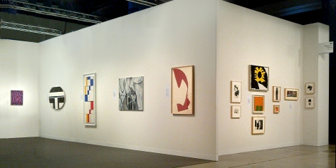 """(from left) Myron Stout, Untitled, c. 1950, oil on canvasboard, 20 x 16 in., Ilya Bolotowsky, """"Black and White Ellipse, 1963, oil on canvas, 30 x 40 in., Leon Polk Smith, """"Diagonal Passage: Red-Blue-Yellow,"""" 1949, oil on canvas, 54 x 20 in., Nicolas Carone, """"Off the Chart,"""" 2009, acrylic on tarpaulin, 33 x 42 in., Leon Polk Smith, Untitled, 1964, torn paper drawing, 39 x 25 in., (right wall) Small works by Nicolas Carone, Reuben Kadish, Alice Trumbull Mason, Doug Ohlson, Ray Parker, Leon Polk Smith, Richard Stankieiwcz, and Jack Youngerman"""