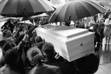Umbrellas over casket by Stephen Barker