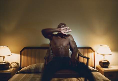 Man in hotel room by Philip-Lorca deCorcia