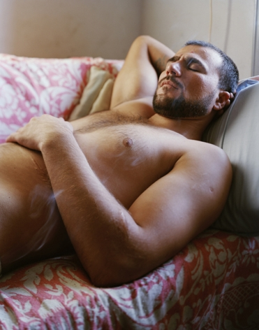 Man on bed by George Awde