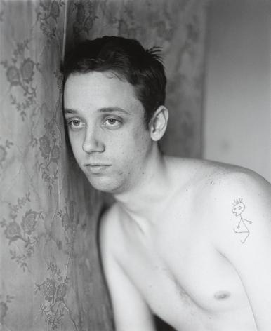 Man leaning on mattress by Stephen Barker