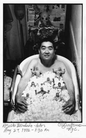 Agosto Machado in bathtub by Don Herron
