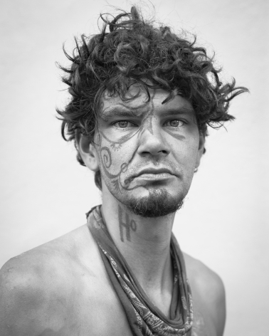 Man with face tattoo by Michael Joseph