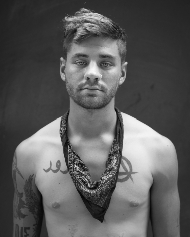 Young man with tattoos by Michael Joseph