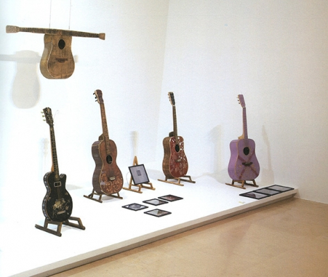 """Bae Young-whan. The Way of Man-Array, 2005. Guitars buil with abandoned wood, Size variable. Installation view of solo exhibition """"Song for Nobody,"""" at PLATEAU, 2012."""