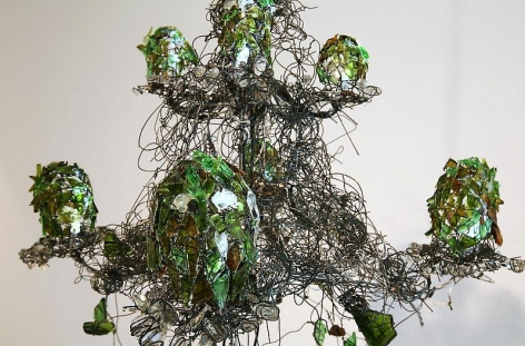 Bae Young-whan. Root in A Minor, 2008. Shards of wine bottles,various liquor bottles, iron,LED lights, epoxy, 130 x 57 (diameter) cm.