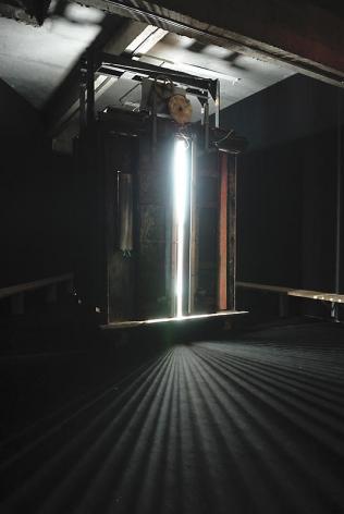 Li Shurui. A Room Called Elevator, 2008.Mixed media (elevator, lights), 250 x 157 x 181 cm.Courtesy of the artist & PKM Gallery.