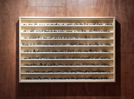 Bae Young-whan. Ten Thousand Years' Sleep – Black, 2010.Black-glaze porcelain objects in artist's cabinet of plywood and glass, 146.5 x 100.5 x 10.5 cm.Courtesy of the artist & PKM Gallery.