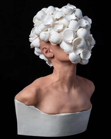 J.J. McCracken  The Feeding  2020, painted platinum silicone lifecast, eggshells, ceramic, 22 x 16 x 12 inches.