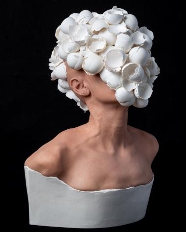 J.J. McCracken  The Feeding  2020, painted platinum silicone lifecast, eggshells, ceramic, 22 x 16 x 12 inches.