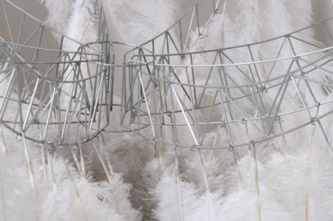MEG MITCHELL Embodied Transcendence / Blast-off (in miniature) 2008, steel wire, ostrich feathers, 48 x 48 inches.