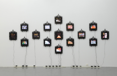 FEDERICO SOLMI Douche Bag City 2010, 15 framed LCD panels with video animation, dimensions variable, ed: 5. Installation view: Conner Contemporary Art.