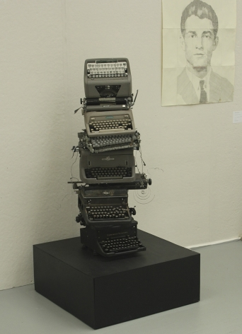 SCARLETT McCALMAN Stack #1 2014, stacked typewriters and gravity on pedestal, 30 x 30 x 15 inches.