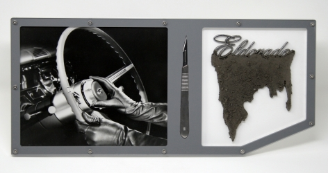 BENJAMIN KELLEY  Untitled 05  2019, Cadillac factory photograph (original), stainless steel scalpel, Cadillac Eldorado script emblem with earth, acrylic, stainless steel hardware, 7.75 x 16.75 x 1 inches.