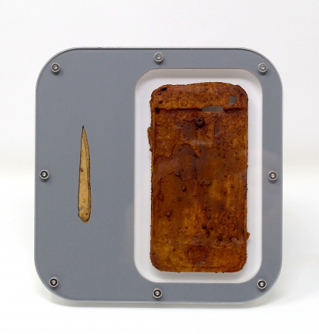 Benjamin Kelley  Untitled 04  2019, Iphone chassis and Iron Oxide, ancient bone tool, acrylic, stainless steel hardware, 6.25 x 6 x 1 inches.