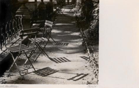 André Kertész - Chairs, The Medici Fountain, Jardin du Luxembourg, 1925    Paris Photo 2019   Bruce Silverstein Gallery