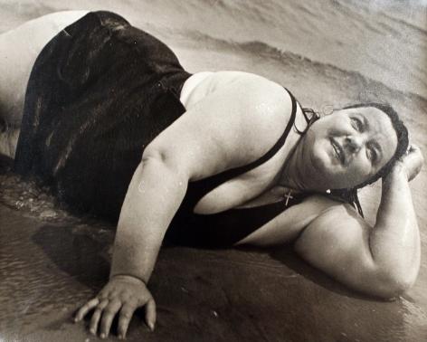 Lisette Model - Coney Island Bather, New York (Reclining), 1939-1940 Gelatin silver print, printed c. 1950 ; Bruce Silverstein Gallery