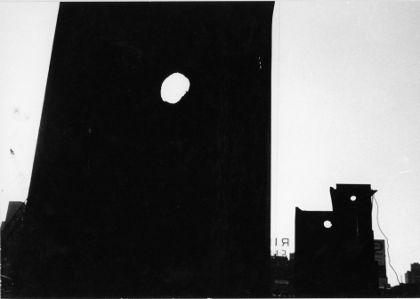 "Louis Draper, Untitled (Dark silhouettes of buildings with three round holes, sign with ""RI""), n.d"