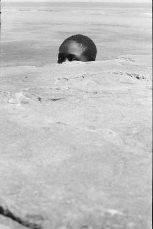 Peeping Sea Wall Beach Boy, Sea Wall, Georgetown, Guyana, 1972