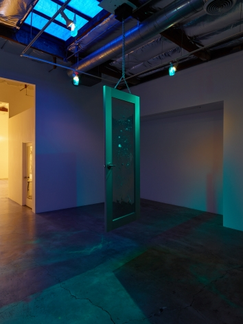 Josh Reames and José Lerma Monument to Wilson and Kelling, 2016 Mirrored door, steel chain, motor, cleaning supply bottles, spotlights Dimensions variable