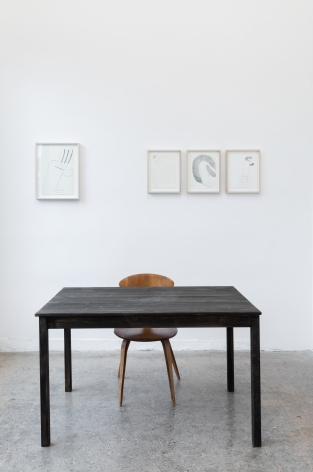 "Installation View of ""Black Elk Speaks"", a collection of drawings and a table and chair in the front room of Gallery 3"