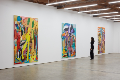 """Installation View of """"Abstraktes Bild Nr. 4710d"""", """" Wer hat Dr. Pfeffer erfunden?,"""", and """"Ernst Ludwig Kirchner Hinrichtung im Jahre 1999"""" with Woman standing next to it for scale"""