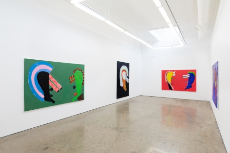 "Installation View of ""Black Elk Speaks"" of a Green, Black, and Red painting by Wulff"