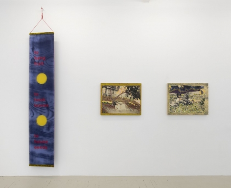 An installation view of works by Crystal Z. Campbell including a textile banner and and 2 mixed media paintings on wood panel