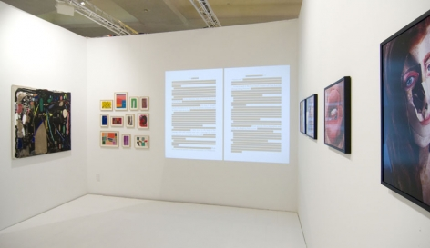 A view of the art booth with artwork on the walls
