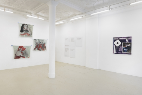 and installation view of the exhibition showing the stacked paintings, the text panels and a purple painting