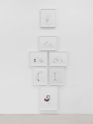 An installation of black-and-white drawings organized in a column on a white wall