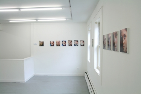 A photograph of 7 images on a wall in the background, and several along the wall at right (barely legible)