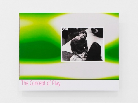 "A ""lobby card"": print on dibond is green-white-yellow like a lava lamp. At the bottom-left in pink letters is written ""The Concept of Play."" At middle-right is a black-and-white photograph of a man with his mouth open, sitting on the ground."