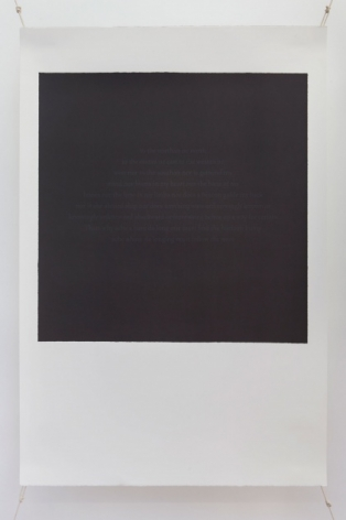 A photograph of a silkscreen on paper. The shape resembles a polaroid (white space on the bottom and a white frame around a central black space). The black space in the middle of the work has text in faint blue letters, illegible from a distance.