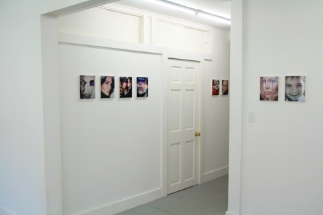 A photograph of 8 images on 2 sets of walls: at left is the hallway with 6 images, and the other 2 are at right in the foreground