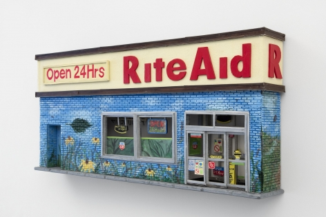 """The facade of a Rite Aid with a mural upon it. There is a sign that says """"Open 24 Hours,"""" and the majority of the facade is blue and green. There is a sliding door, and 2 windows. The work is hung on the wall."""
