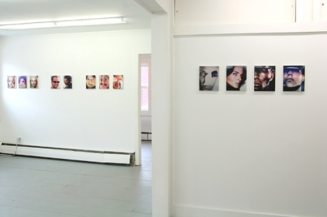 A photograph of 12 images across 2 wall: 1 in the background (8 total) and 1 in the foreground