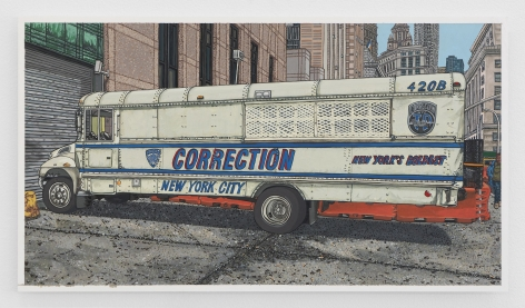 A white NYPD Corrections bus parked in a cement driveway, with NYC buildings in the background.