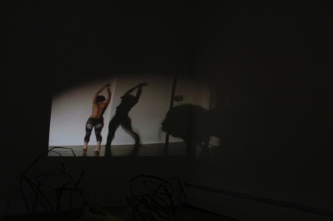 A photograph of a video projection, the room is otherwise dark