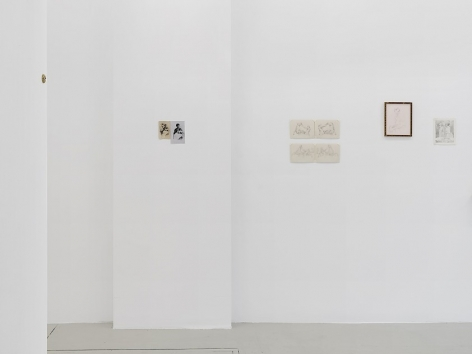 An installation view of 3 works on paper installed on the wall, without frames
