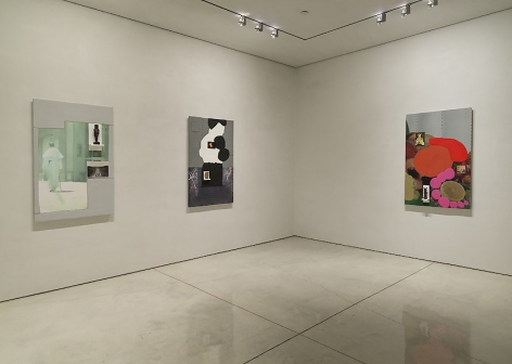 A photograph of three mixed media works installed at Mary Boone Gallery.