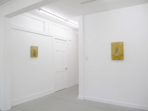 A photograph of 2 artworks on 2 white walls, perpendicular to one another