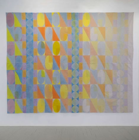 A wall-sized painting on drop cloth of geometric shapes
