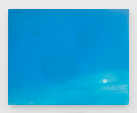 A painting on canvas. The majority is sky blue, and transitions to a paler hue toward the bottom-right. There are three spheres: 2 semi-large blue shapes in the center; at right is a small white circle.
