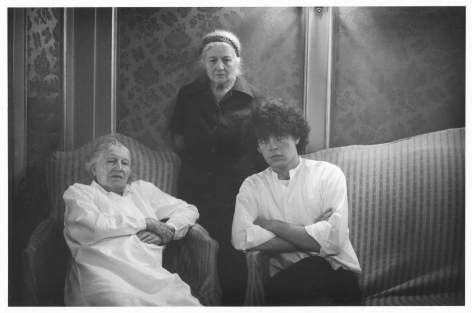 A black and white photograph of Guibert with his two older aunts, sitting on lush couches