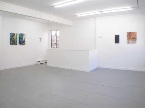 A photograph of 5 works on 2 walls
