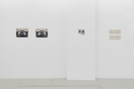 An installation view of 2 photographs, and 2 drawings, installed on the wall without frames